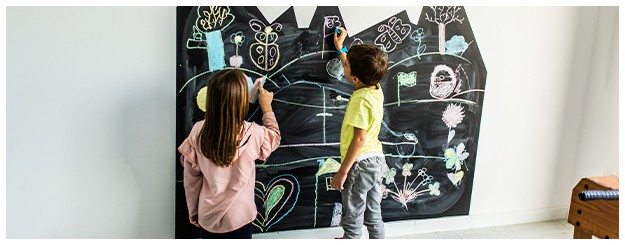 decorated walls in basement playroom